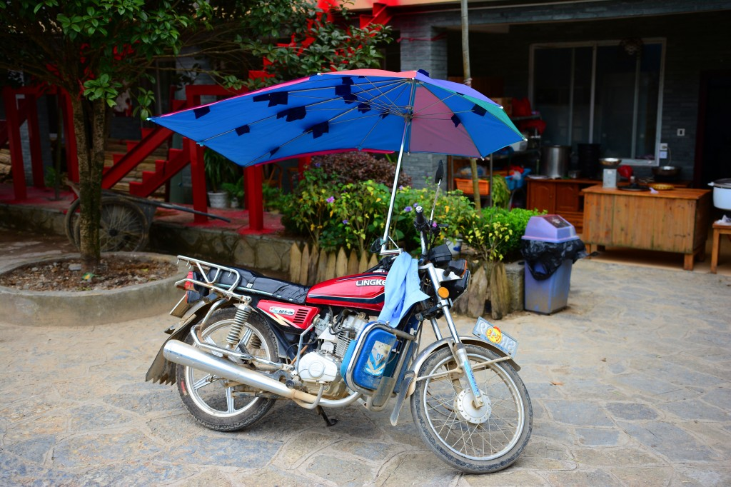 lots of motorbikes in the area are fitted with these umbrellas
