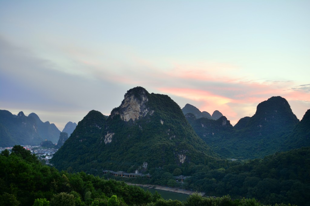 sunset over Lijiang from our hotel balcony