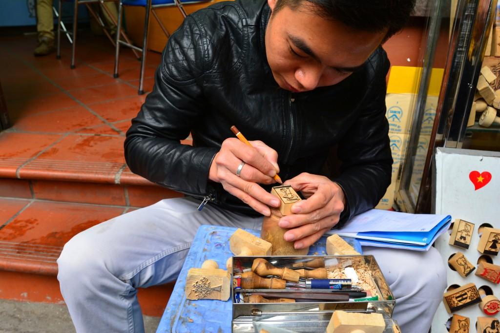 stamp maker on a street corner